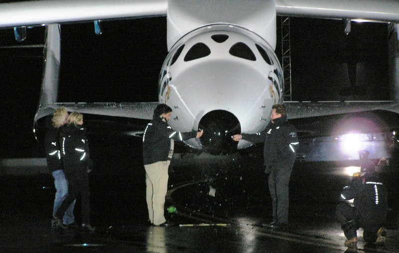 New Mexico's Gov. Richardson and California's Gov. Schwarzenegger christen SpaceShipTwo as the VSS Enterprise. Sir Richard Branson and his daughter stand off to the left as the Champaign bottles smash against the nose of SpaceShipTwo.
