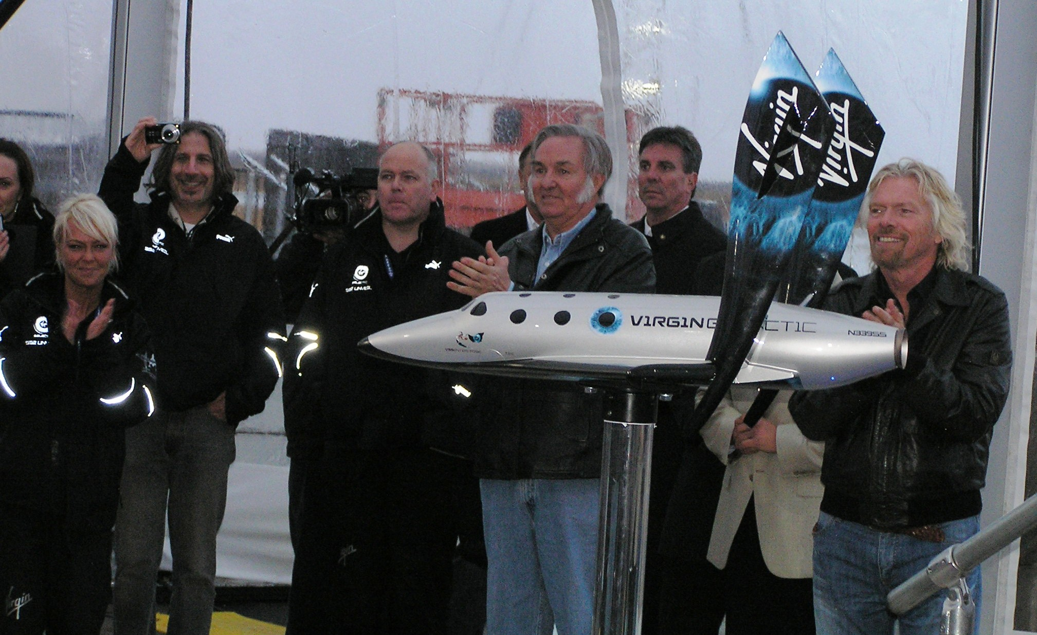 At the press conference, Sir Richard Branson and Burt Rutan stand behind the SpaceShipTwo model. The designs for both SpaceShipTwo and WhiteKnightTwo were previously unveiled in January 2008.